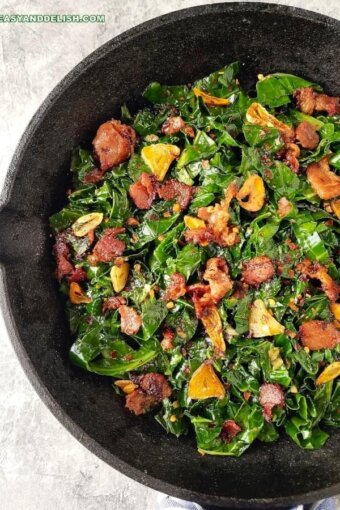 a skillet with fried collard greens and bacon