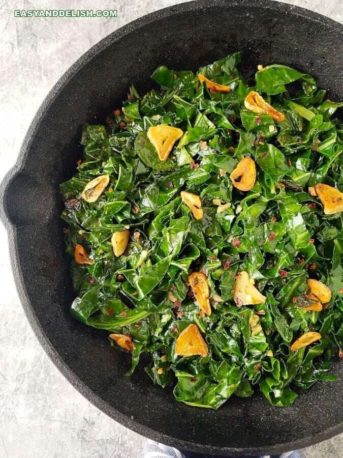 Close up of fried collard greens in a skillet
