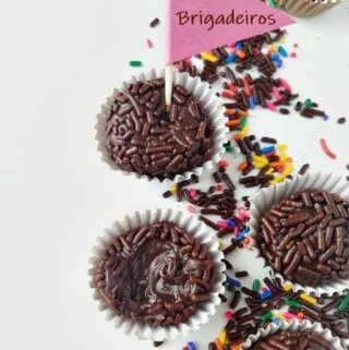 brigadeiro candies on a table with a little flag on top
