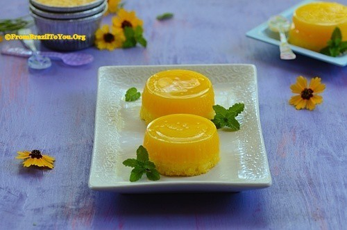 Two bright yellow round quindim custards on a plate