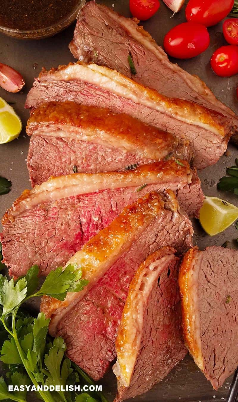sliced oven baked rump cover or culotte with garnishes