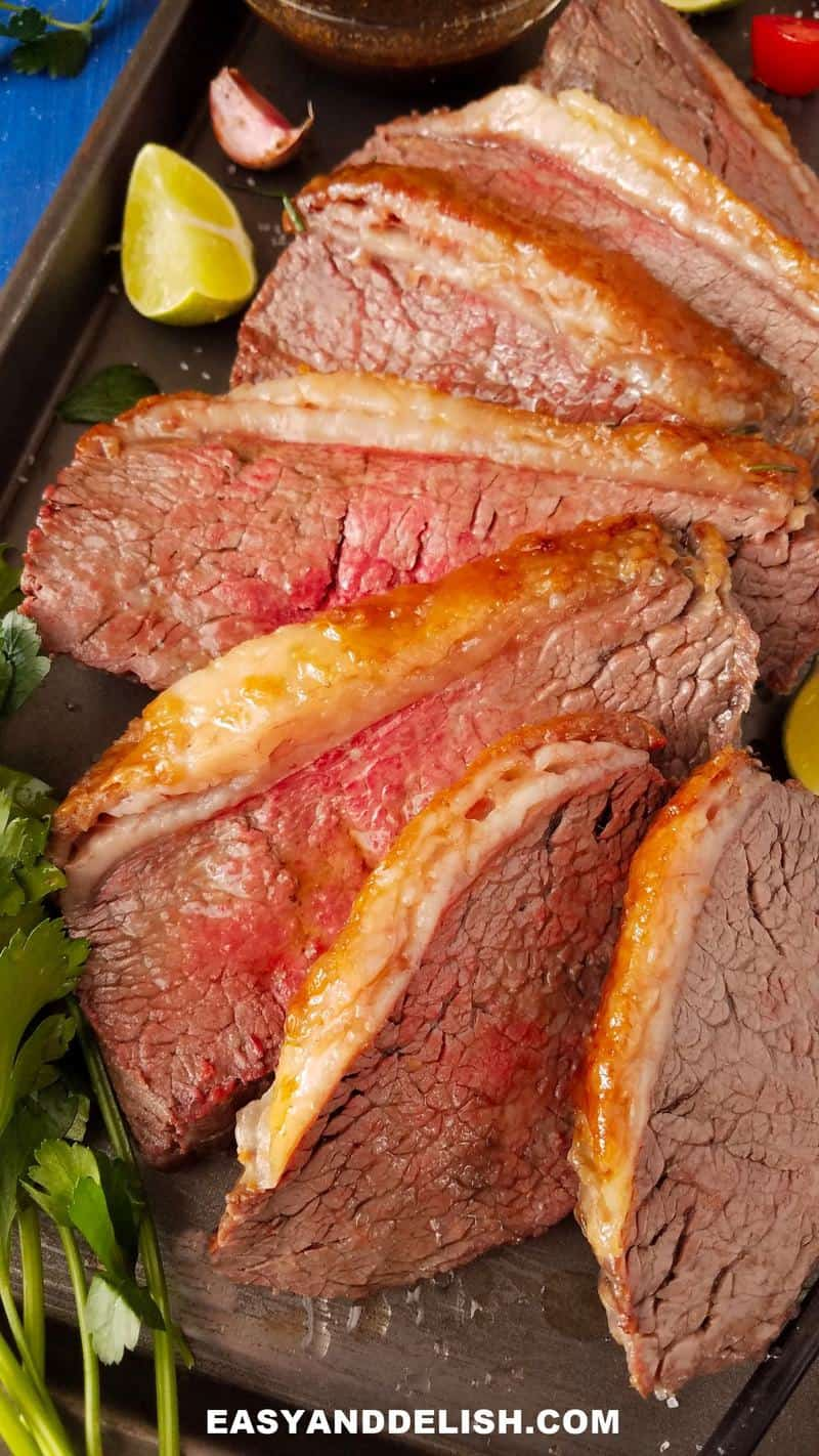 sliced picanha roast in a baking pan