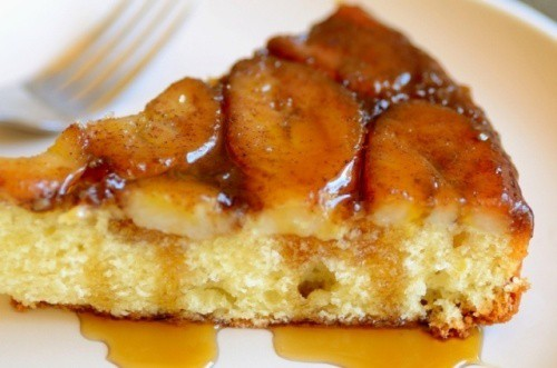 close up image of a slice of Spiced Banana Upside Down Cake served in a plate