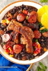 a bowl of Feijoada with orange slices