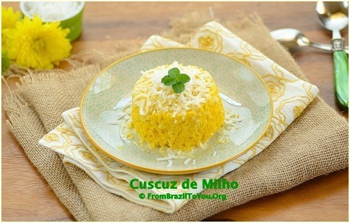 Cornmeal couscous or cuscuz de milho on a white plate