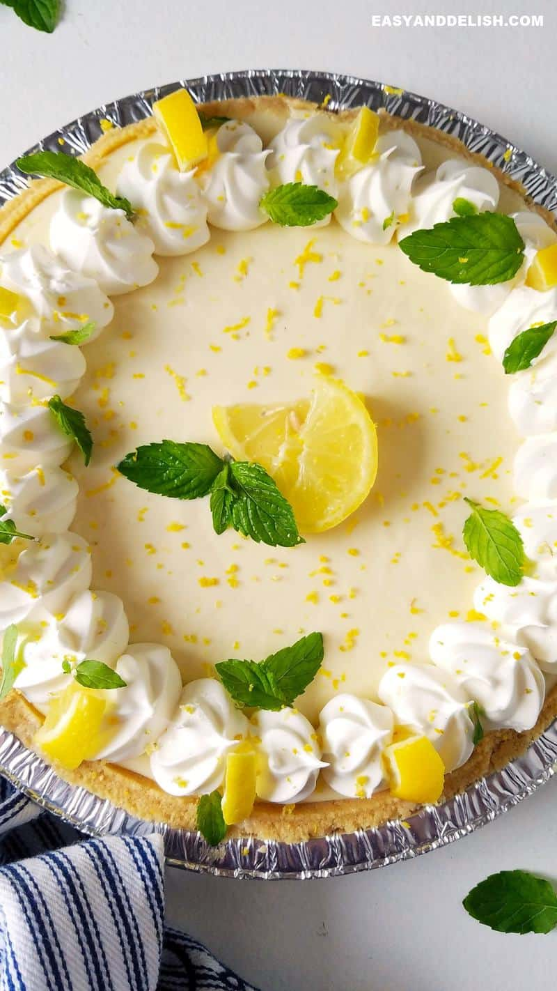 close up shot of whole lemon pie with condenssed milk