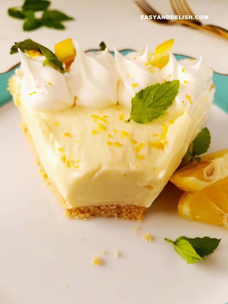 a partially eaten slice of lemon pie