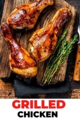 close up of grilled chicken drumsticks with herbs and spices on a cutting board