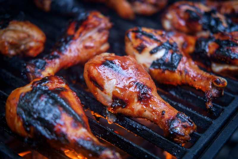 chicken legs on a charcoal grill