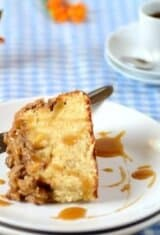 A slice of apple streusel cake in a plate