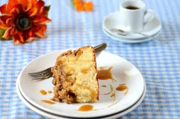 a slice of apple streusel cake  with a fork on the side