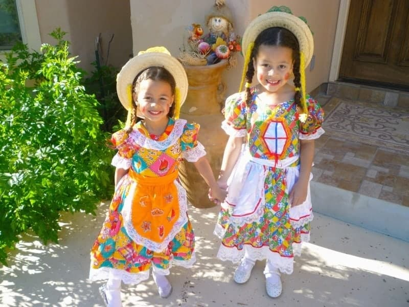 Two little girls standing in front of Halloween decoration