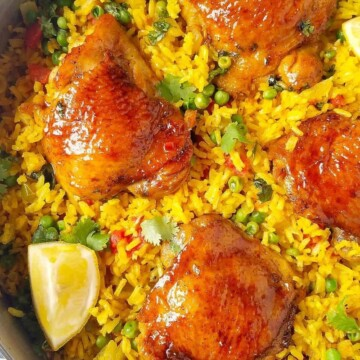 close up of galinhada mineira (Brazilian saffron rice with chicken) in a pan
