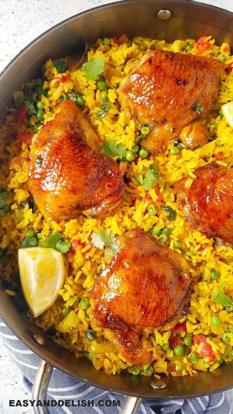close up of galinhada mineira (Brazilian saffron rice with chicken) in a pan