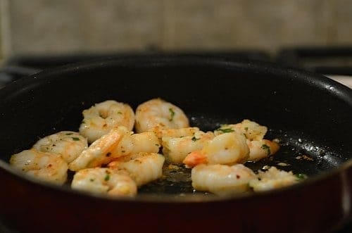 shrimp being cooked in a pan