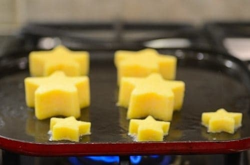 star-shape polenta being fried in a pan
