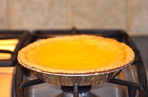 A close up of a buttermilk pie on top of the stove