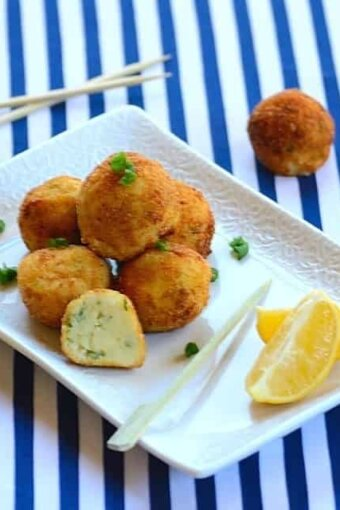 A plate of cod cakes with garnishes