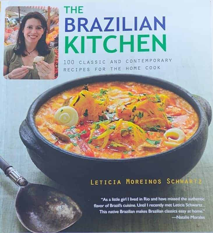 A bowl of soup on the cover of a cookbook