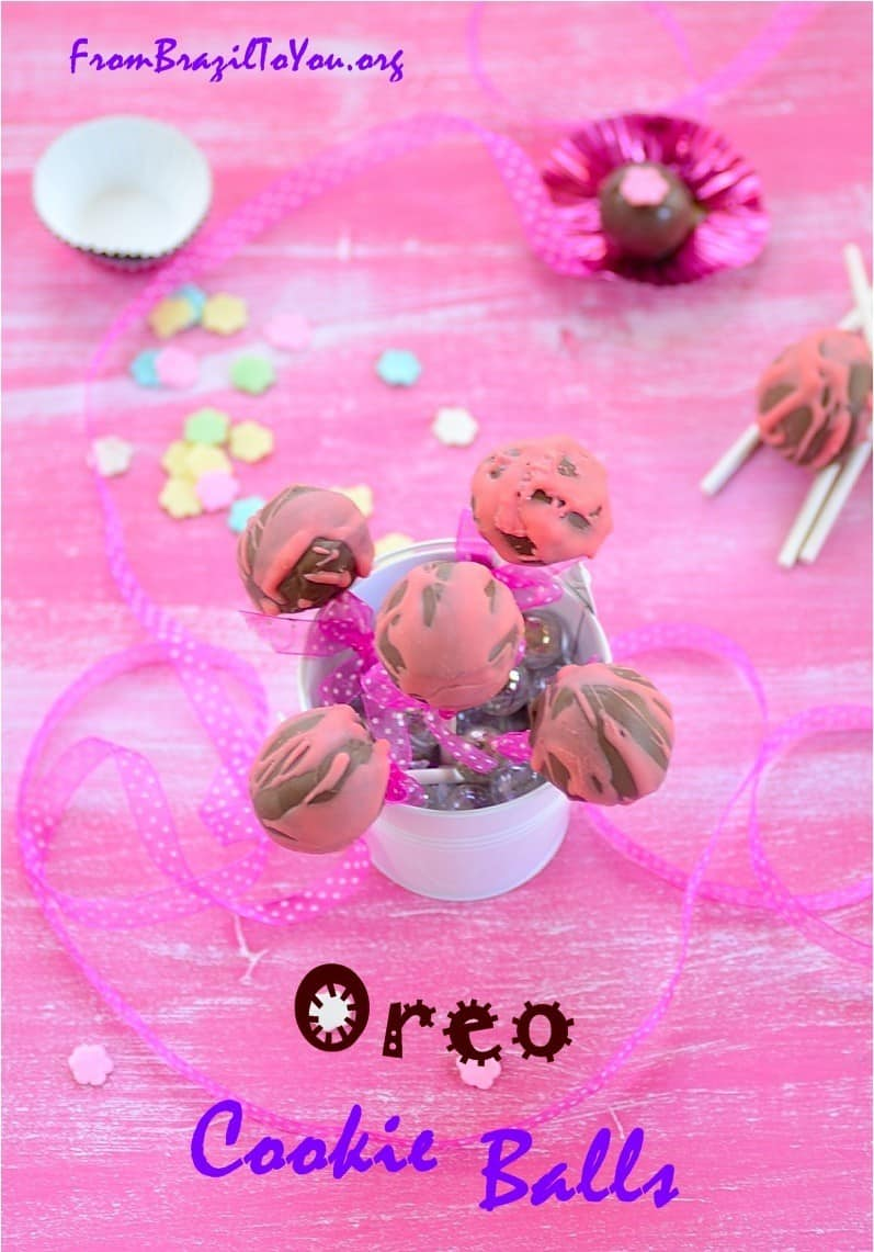 Oreo cookie balls in a jar and others on the top of a table