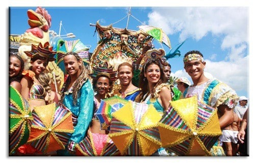 A group of people posing for the camera with carnival umbrellas