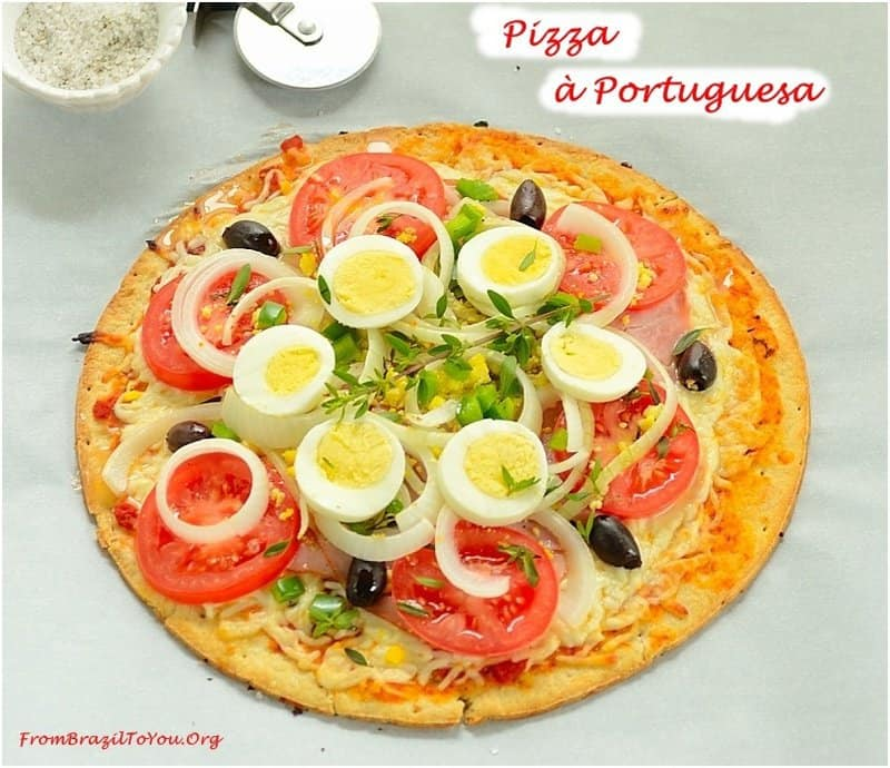Pizza a Portugesa or Portuguese style pizza with hard boiled eggs and chouriço sausage