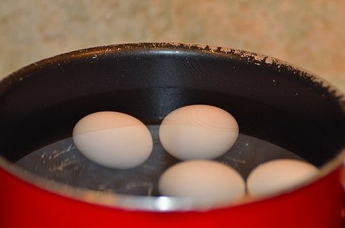 Boiling eggs in a pan