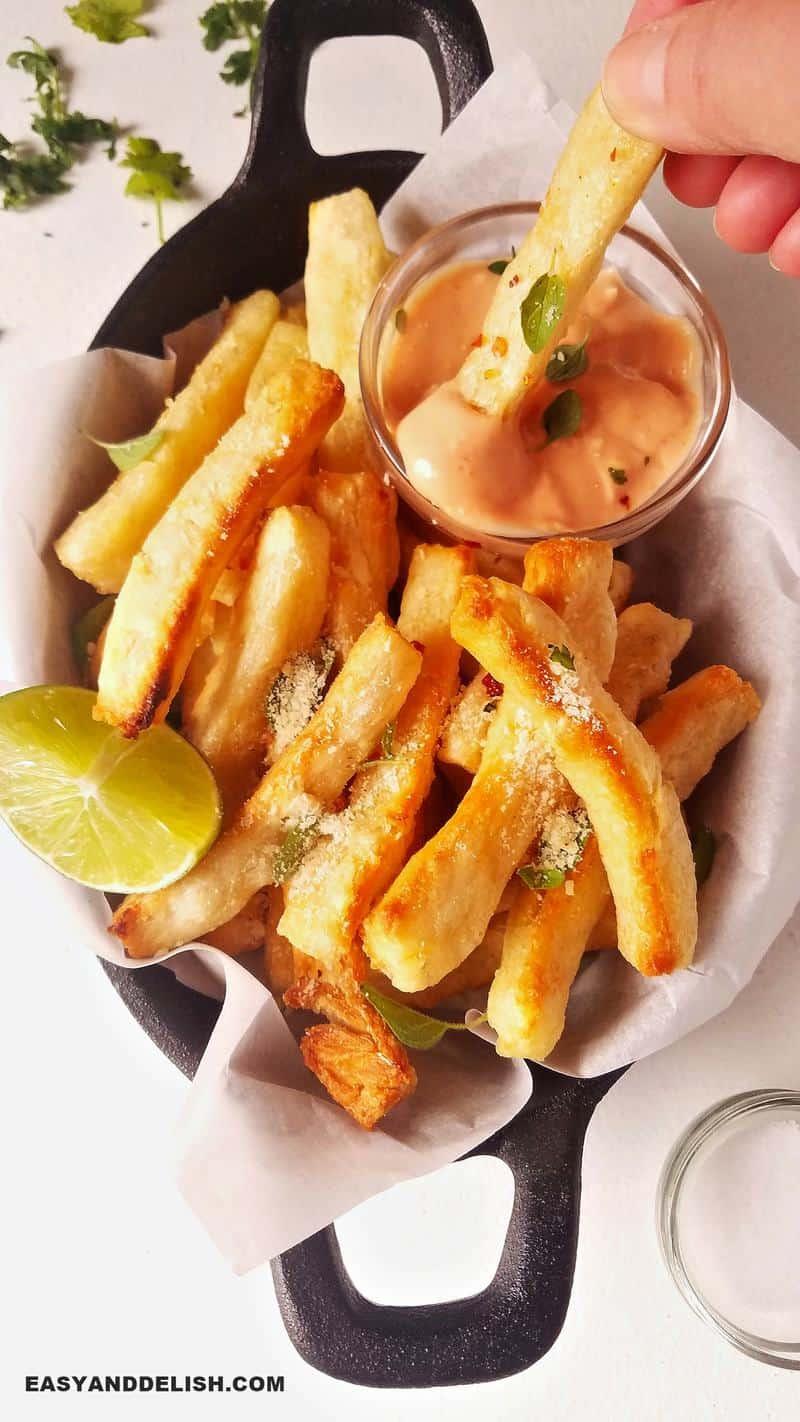 yuca fries dipped in sauce