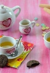 A tea set on a table with tea and cookies