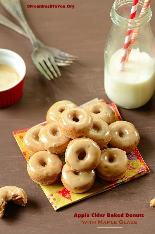 Apple Cider Baked Donuts with Maple Glaze. over a napkin with milk on the side