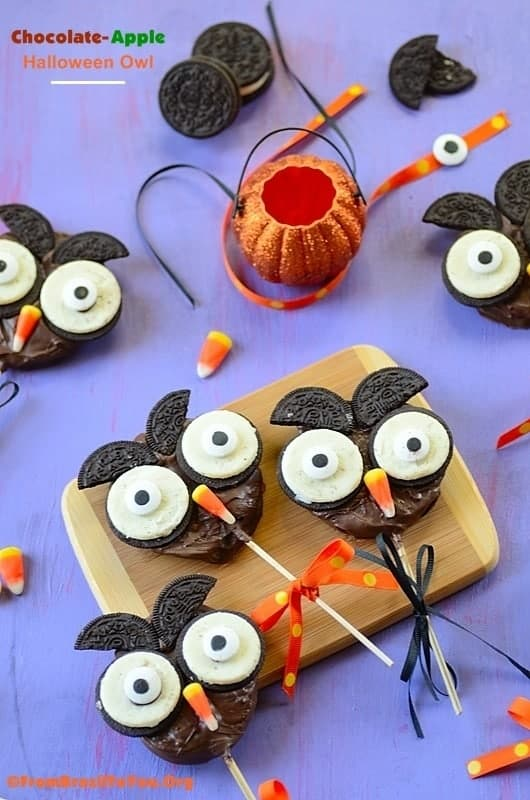 Chocolate Apple Halloween Owl on a table. One of the cutest Halloween treats recipes ever!