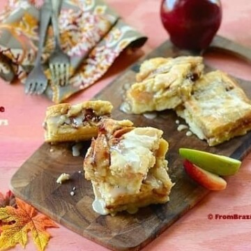 slices of apple cobbler bars on a platter with garnishes on the sides