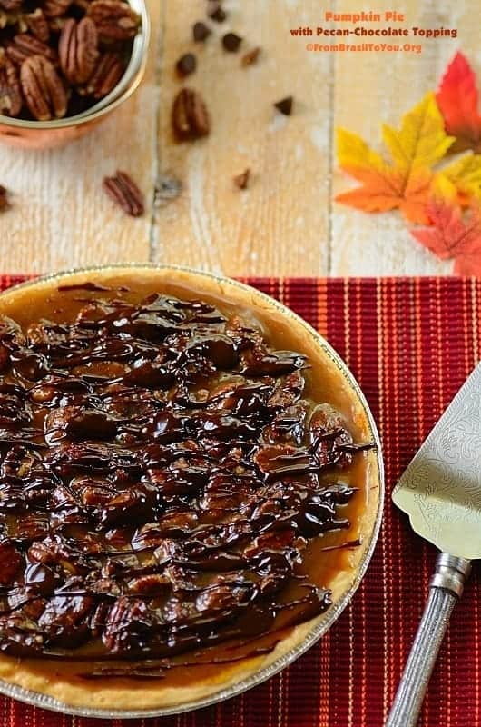 Best Pumpkin Pie with Pecan-Chocolate Topping with a slicer and nuts
