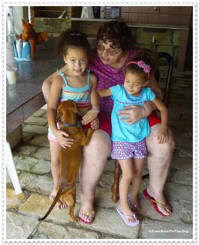 My children with Aunt Graça and her dog in Porto de Galinhas Beach...