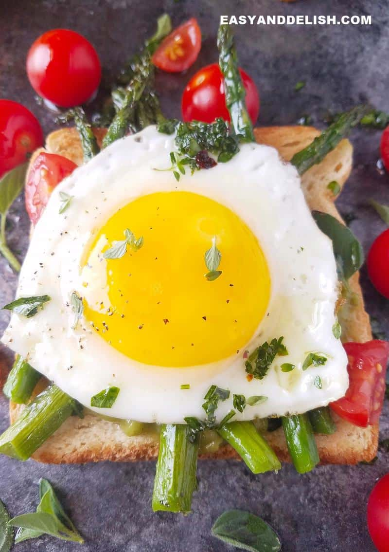 close up of sunny side up eggs on a toast