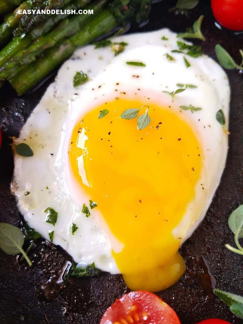 runny soft egg yolk in a skillet