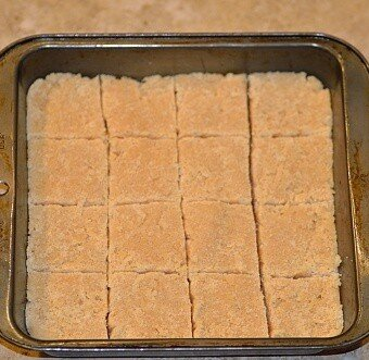 Brazilian coconut bars or cocada de leite condensado cut into squares in a pan