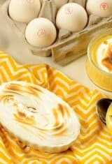 passion fruit pies on a table with a bow of eggs on the background
