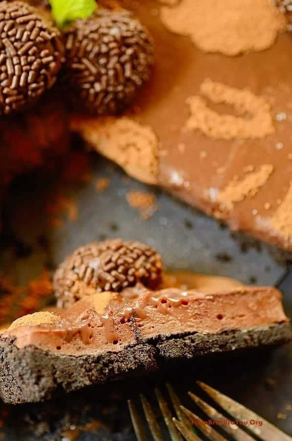 Triple Brigadeiro Cheesecake Tart image showing a slice half way up