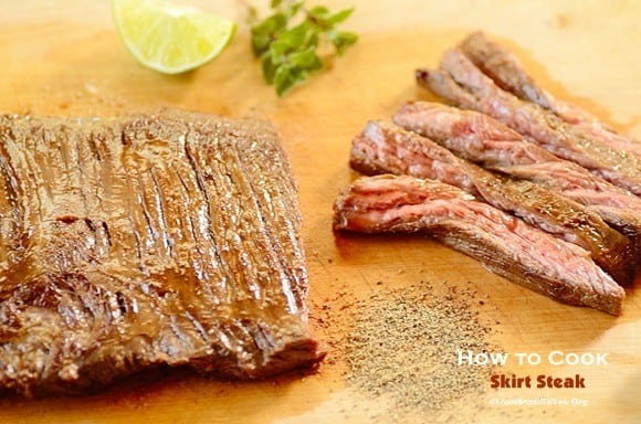 whole and sliced skirt steak on a board