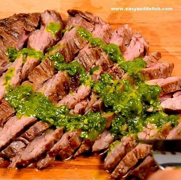 sliced skirt steak with chimichurri sauce on top