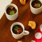 mini cups with bean broth on a platter