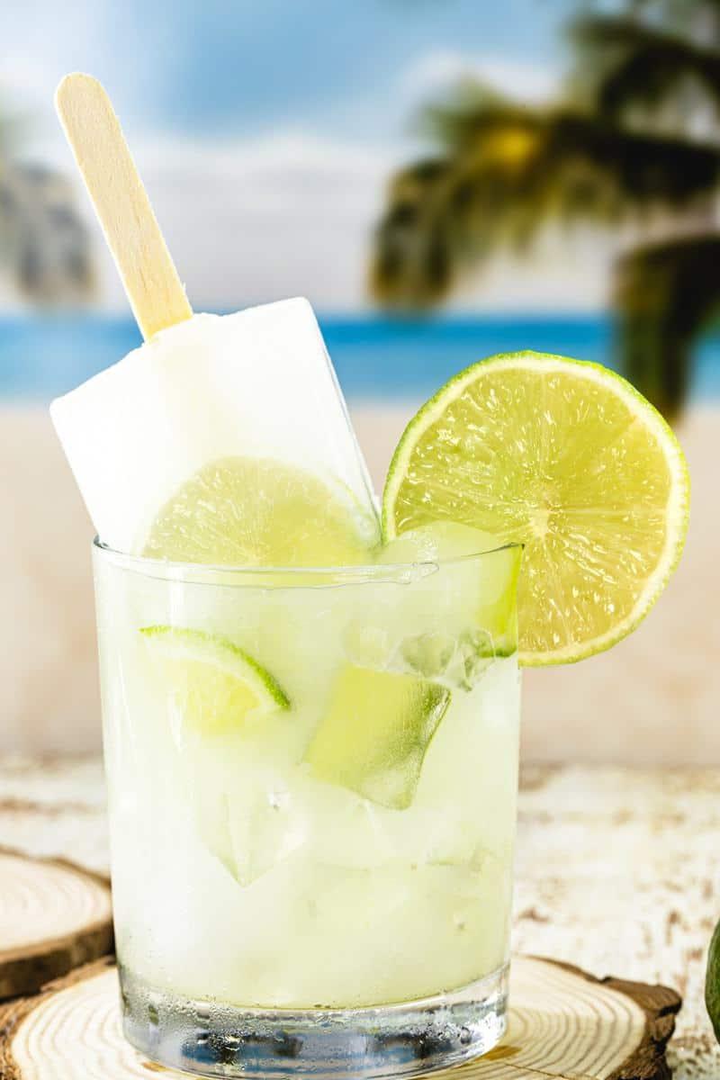 A glass of Brazilian lemonade with a popsicle inside