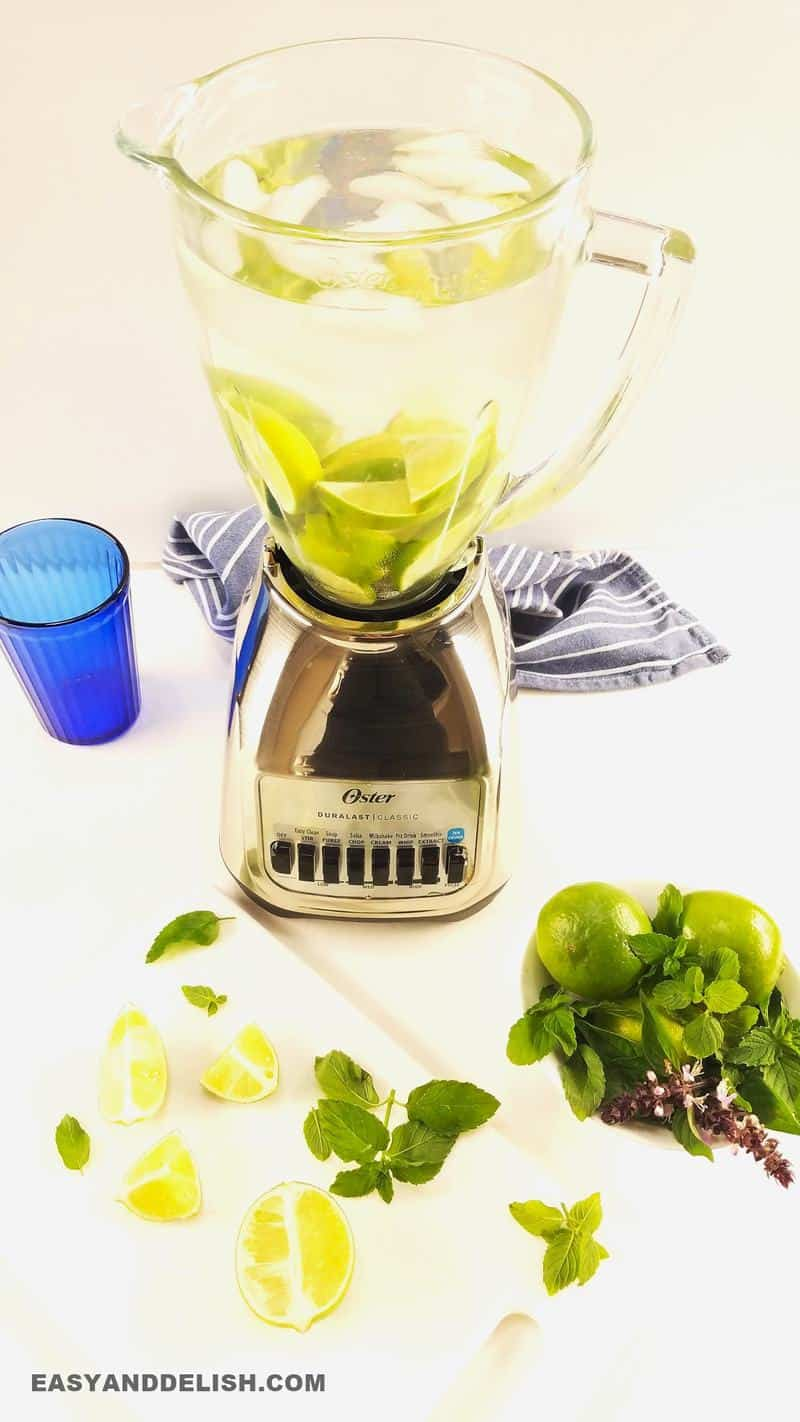 limes with sugar, water, and ice in a blender.