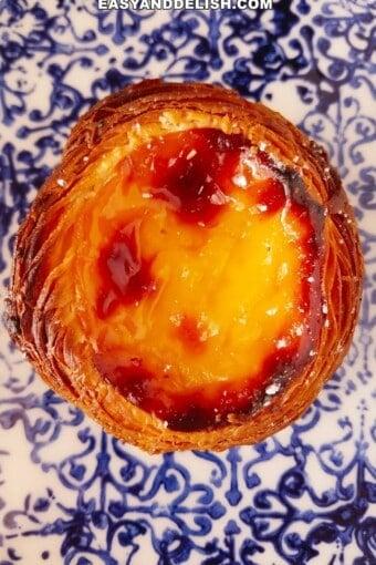 close up of pastel de nata over a plate
