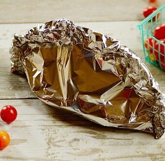 fish stew sealed in the aluminum packets (en papillote)