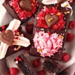 several valentine's day brownies in a platter