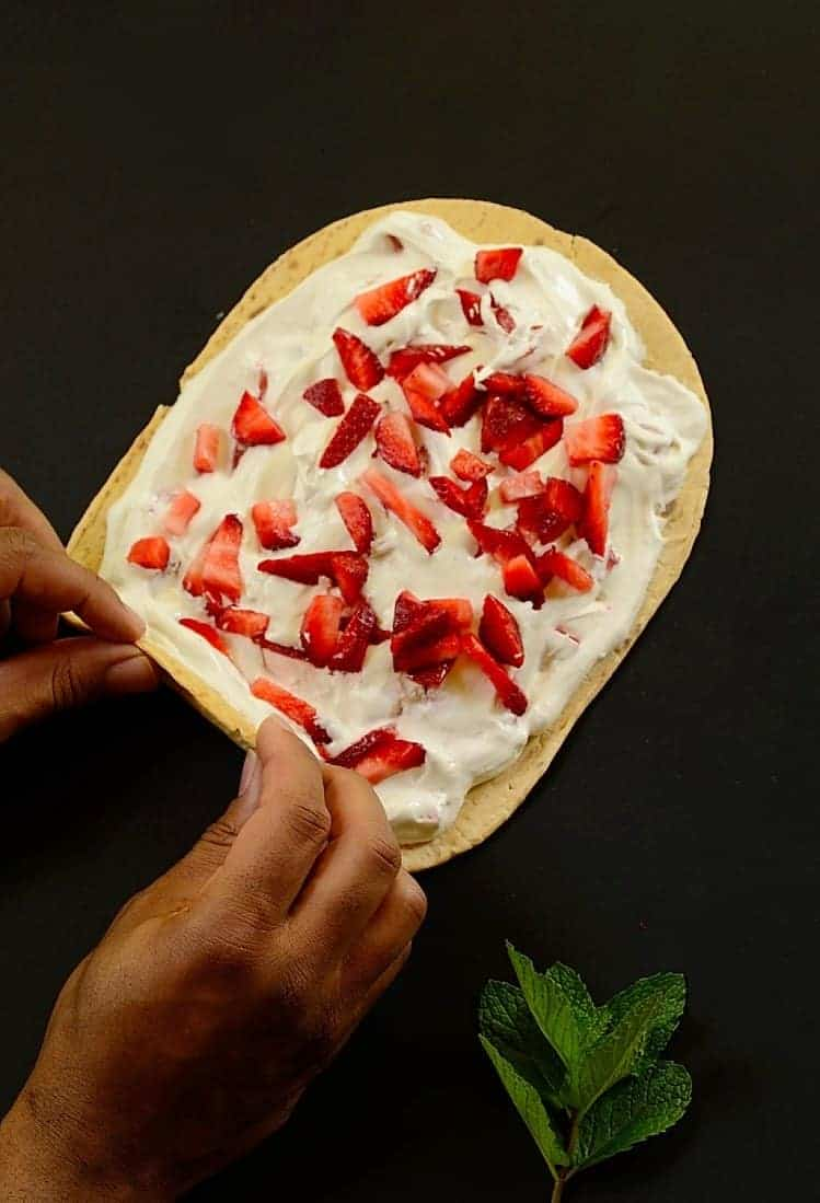 Rolling-up-strawberry-cream-flatbread-roll