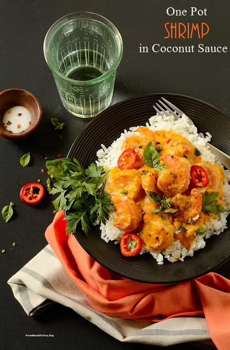 One pot shrimp in coconut sauce on a black plate, also called Camarão no leite de coco