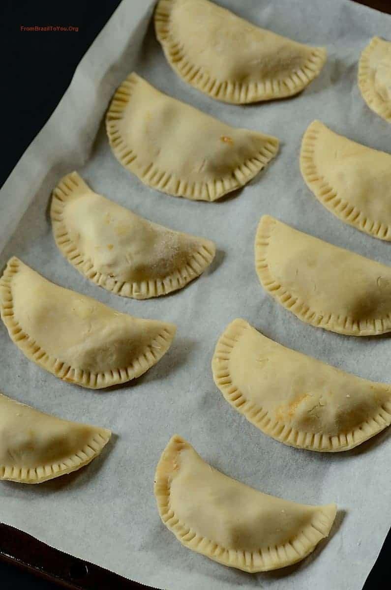 Baking Dulce de Leche Apple Hand Pies onto a lined baking pan before baking